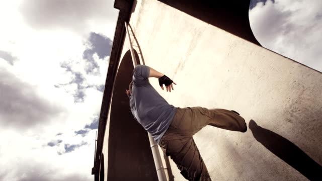 HD Super Slow-Mo: B-Boy Performing A Wall Flip video