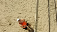 HD Super Slow-Mo: Beach Volleyball Player Serving video