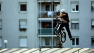 HD Super Slow-Mo: Bmx Dirt Rider Doing X-Up Trick video