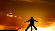HD Super Slow-Mo: Bmx Dirt Rider Jumping At Sunset video