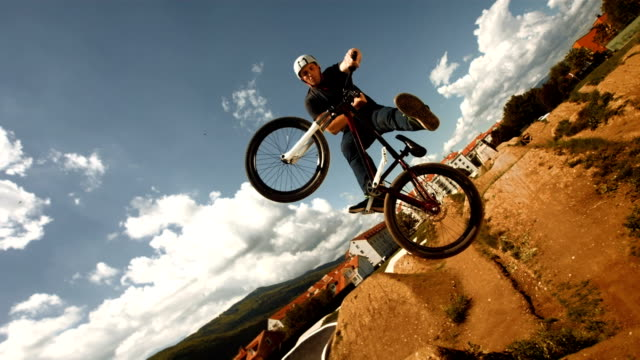 HD Super Slow-Mo: Bmx Dirt Rider Performing Unturndown Trick video