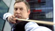 HD Super Slow-Mo: Businessman Shooting An Arrow video