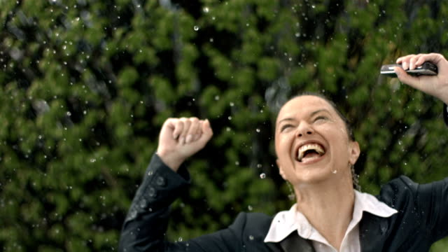 HD Super Slow-Mo: Cheerful Businesswoman In The Rain video