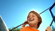 HD Super Slow-Mo: Cheerful Little Boy Swinging video