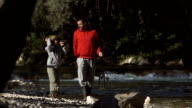HD Super Slow-Mo: Cheerful Son Fishing With Father video
