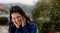 HD Super Slow-Mo: Cheerful Woman Dancing In The Rain video