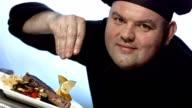 HD Super Slow-Mo: Chef Sprinkling Seasoning video