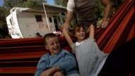 HD Super Slow-Mo: Children Having Fun In Hammock video