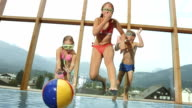 HD Super Slow-Mo: Children Jumping Into The Pool video