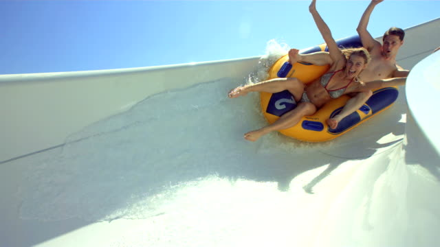 HD Super Slow-Mo: Couple Having Fun On A Water Slide video