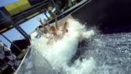 HD Super Slow-Mo: Couple Having Fun On Raft Water Slide video