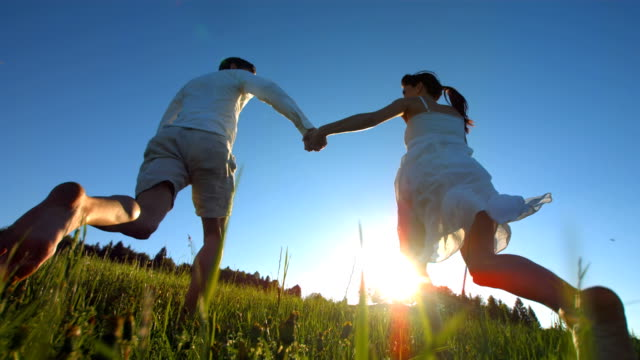 HD Super Slow-Mo: Couple Running In Grass At Sunset video