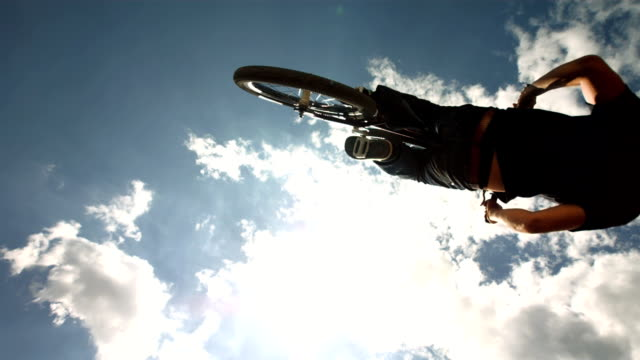 HD Super Slow-Mo: Dirt Backflipping Against Cloudy Sky video