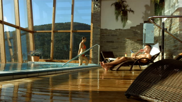 HD Super Slow-Mo: Enjoying Luxury Pool Villa video