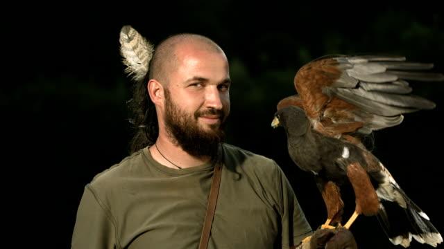 HD Super Slow-Mo: Falconer Posing With Harris Hawk video