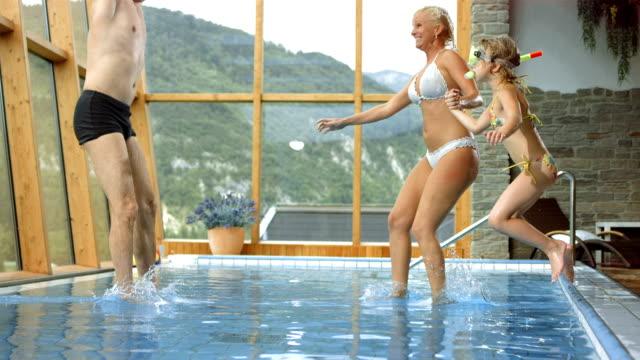 HD Super Slow-Mo: Family Having Fun Jumping Into Pool video