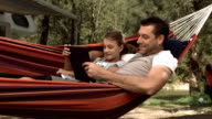 HD Super Slow-Mo: Father And Daughter Using A Digital Tablet video
