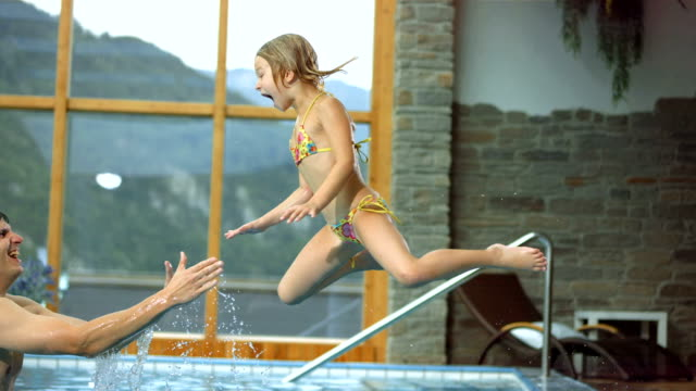 HD Super Slow-Mo: Father Catching Daughter In The Pool video