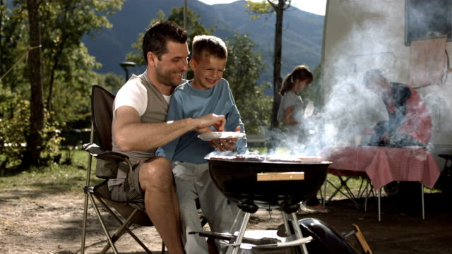 HD Super Slow-Mo: Father Teaching His Son How To BBQ video