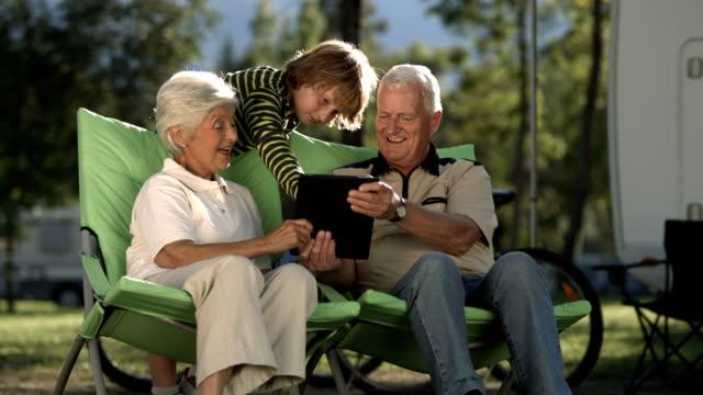 HD Super Slow-Mo: Grandson Teaching Grandparents Using Digital Tablet video