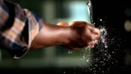 HD Super Slow-Mo: Hands Catching Falling Water video