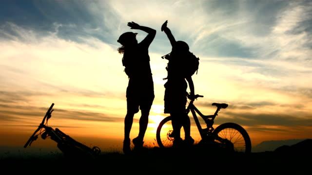 HD Super Slow-Mo: Happy Bikers Giving A High-Five video