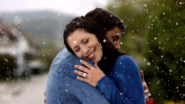 HD Super Slow-Mo: Happy Couple Embracing In The Rain video