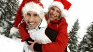 HD Super Slow-Mo: Happy Couple With Santa Hats video