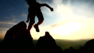 HD Super Slow-Mo: Hiker Jumping Over Rocks At Dusk video