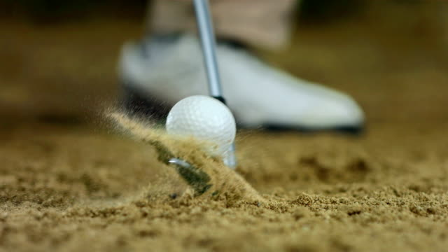 HD Super Slow-Mo: Hitting Ball From Sand Trap video