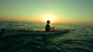 HD Super Slow-Mo: Kayaking In The Sea At Sunset video