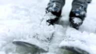HD Super Slow-Mo: Kicking Snow Off Skis video