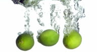 HD Super Slow-Mo: Limes Splashing Into Water video