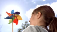 HD Super Slow-Mo: Little Girl Playing With Pinwheel video