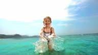 HD Super Slow-Mo: Little Girl Splashing Water At Camera video