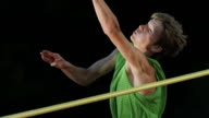 HD Super Slow-Mo: Male Athlete Jumping Over A Horizontal Bar video