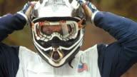 HD Super Slow-Mo: Motocross Rider Preparing For A Ride video