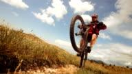 HD Super Slow-Mo: Mountain Biker Speeding On The Rear Wheel video