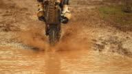 HD Super Slow-Mo: MX Rider Splashing Through Mud video