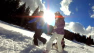 HD Super Slow-Mo: Parents Pulling Kids On Sledge video