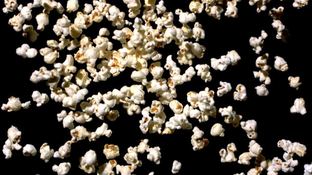 HD Super Slow-Mo: Popcorn Falling Over Black Background video