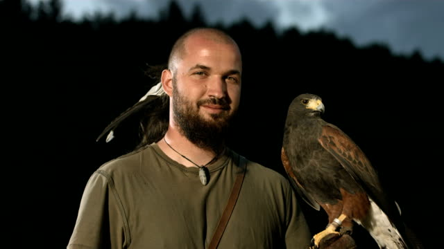 HD Super Slow-Mo: Portrait Of Falconer With A Hawk video