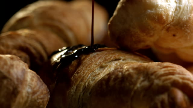 HD Super Slow-Mo: Pouring A Chocolate Syrup Over Croissants video