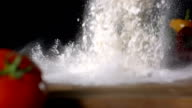 HD Super Slow-Mo: Pouring Flour On A Cooking Table video
