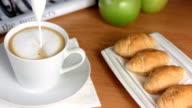 HD Super Slow-Mo: Pouring Foamed Milk Into Espresso video