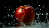 HD Super Slow-Mo: Pouring Water Over An Apple video