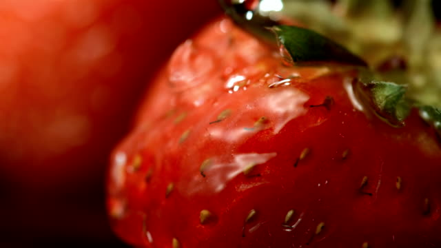 HD Super Slow-Mo: Pouring Water Over Strawberry video