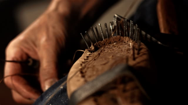HD Super Slow-Mo: Shoemaker Sewing The Upper To Insole video