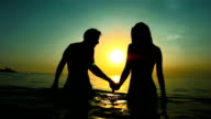 HD Super Slow-Mo: Silhouette Of Couple In The Sea video