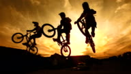 HD Super Slow-Mo: Silhouette Of Stunt Bmx Riders video